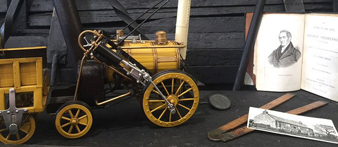 Display of items relating to George Stephenson, including a model of Locomotion No. 1